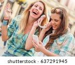 two beautiful young women... | Shutterstock . vector #637291945