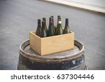 cardboard box with empty wine... | Shutterstock . vector #637304446