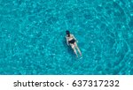 people swimming in the hotel... | Shutterstock . vector #637317232