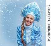 Small photo of Snow Maiden. Winter portrait of a beautiful young smiling woman