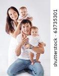 studio portrait of happy young... | Shutterstock . vector #63735301