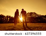 happy couple at sunset in park... | Shutterstock . vector #637396555