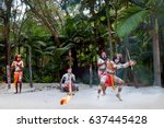 Small photo of Group of Yugambeh Aboriginal warriors dancing and play music on Australian Aboriginal culture show in Queensland, Australia.