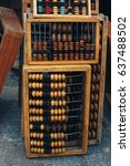 Small photo of Old wooden abacus on abacus background