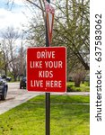 "Small photo of ""Drive like your kids live here"" bright red sign alerting drivers to be alert for children playing in the area"