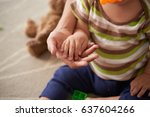 little palm of kid in hand of...   Shutterstock . vector #637604266