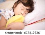 asian little girl sleeping on... | Shutterstock . vector #637619326