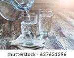 glass of water on a wooden... | Shutterstock . vector #637621396
