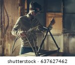 Stock photo welding device hanging in workplace 637627462