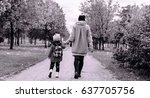 mom and daughter go to the park ... | Shutterstock . vector #637705756