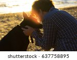 Stock photo man and his dog on the beach best friends 637758895