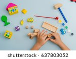 child collects and paints a... | Shutterstock . vector #637803052