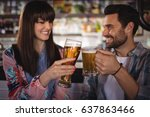 happy couple toasting glasses... | Shutterstock . vector #637863466
