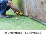 artificial grass being... | Shutterstock . vector #637895878