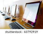 photo of row of computers in... | Shutterstock . vector #63792919