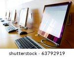 photo of row of computers in... | Shutterstock . vector #63792919