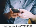 businessman using smartphone at ...   Shutterstock . vector #637959532