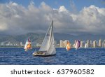 Small photo of Honolulu, Hawaii, USA, May 11, 2017: Waikiki Sailboat Fleet out for a late evening sail with Honolulu and Oahu in the background.