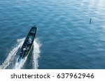 a man riding the boat with his... | Shutterstock . vector #637962946