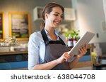 woman working in coffee shop  | Shutterstock . vector #638044708