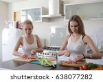 two women are cooking in the...   Shutterstock . vector #638077282