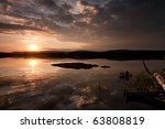sunset on the water - stock photo