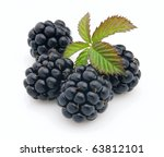 Ripe blackberry with leaves - stock photo
