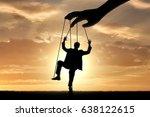 hand controls man marionette.... | Shutterstock . vector #638122615