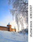 tree in snow against old... | Shutterstock . vector #63813307