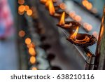coconut oil lamps in temple | Shutterstock . vector #638210116