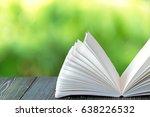 open book on wood planks over... | Shutterstock . vector #638226532