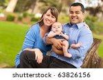 Happy Mixed Race Family Posing...
