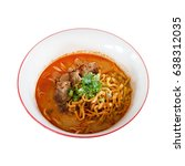egg noodle in braised pork curry | Shutterstock . vector #638312035