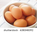 fresh eggs in a bowl | Shutterstock . vector #638348392