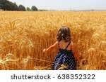 child in a field of wheat | Shutterstock . vector #638352322