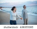 beautiful couple walking on the ... | Shutterstock . vector #638355385
