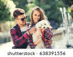 Stock photo young couple with puppy portrait of attractive happy smiling young woman and man holding cute 638391556