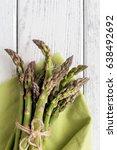 fresh asparagus on wooden... | Shutterstock . vector #638492692