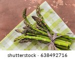 fresh asparagus on concrete... | Shutterstock . vector #638492716