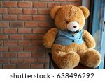teddy bear red brick wall... | Shutterstock . vector #638496292
