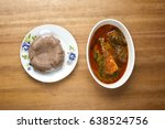 Small photo of A plate of amala served with ewedu,gbegiri, titus fish and pieces of beef