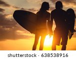 couple of surfers standing on... | Shutterstock . vector #638538916