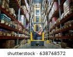 worker in forklift truck... | Shutterstock . vector #638768572