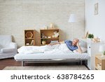 young man in bed relaxing in... | Shutterstock . vector #638784265