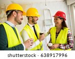 team of smiling architects at... | Shutterstock . vector #638917996
