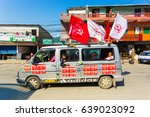Small photo of Pokhara, Nepal - May 11, 2017: Maoist Communist Party supporters waving flags and riding vans during campaign for the 2017 national elections