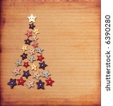 Shabby, folk-art, button christmas tree on corrugated board. - stock photo