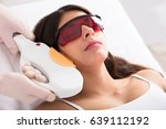young woman receiving laser... | Shutterstock . vector #639112192