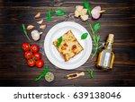 portion of tasty lasagna on... | Shutterstock . vector #639138046