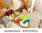 happy kid boy washing dishes in ... | Shutterstock . vector #639153622